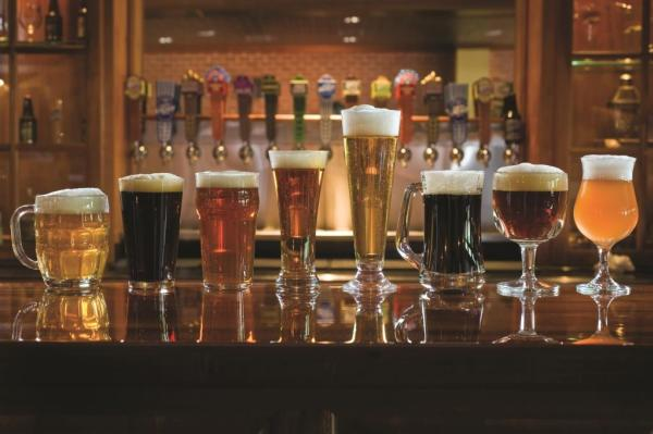 Abita beer in glasses on tasting room bar