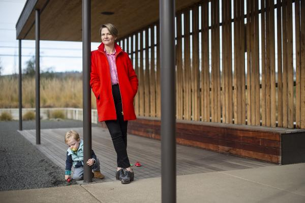 Winemaker Brianne Day with son Viggo in front of her winery