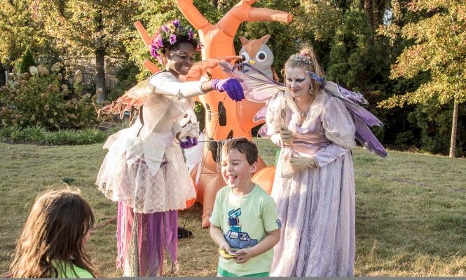 Spooky Springs fairies playing with children at Abernathy Greenway Playable Art Park