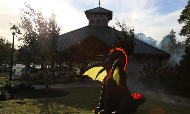Inflatable dragon at Abernathy Greenway Playable Art Park for the Annual Spooky Springs event