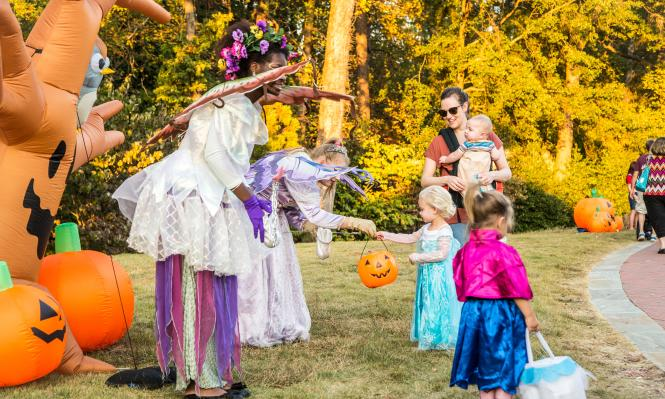 Fairies at Spooky Springs passing out candy to children dressed as Elsa and Anna