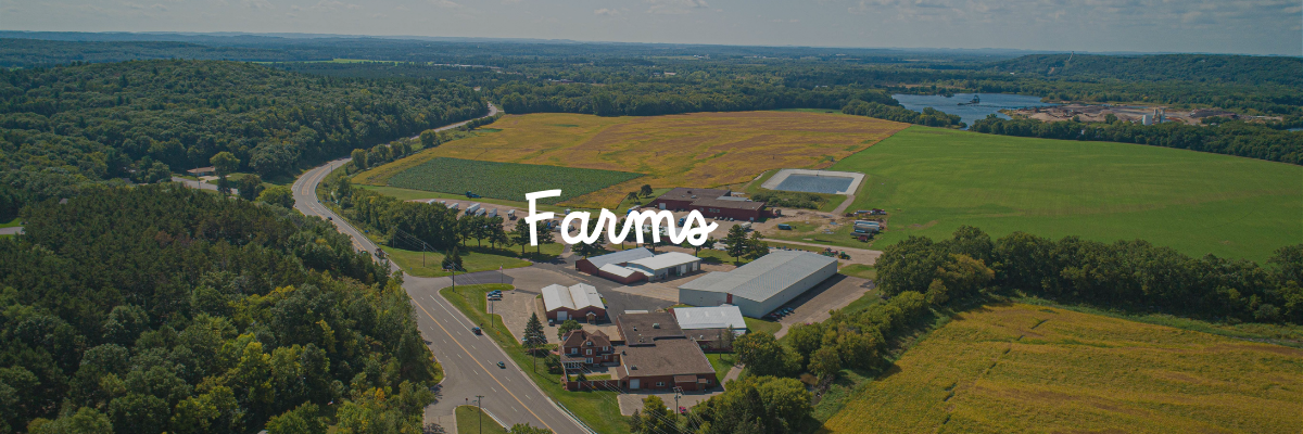 "An aerial view of Huntsinger Farms with the word ""farms"" on top of the image"