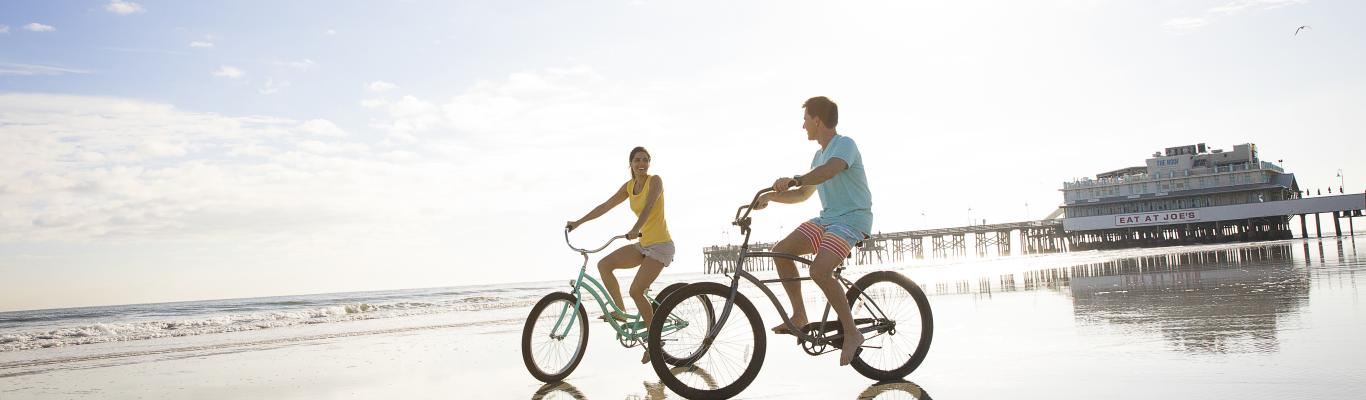 Couples on bikes on beach