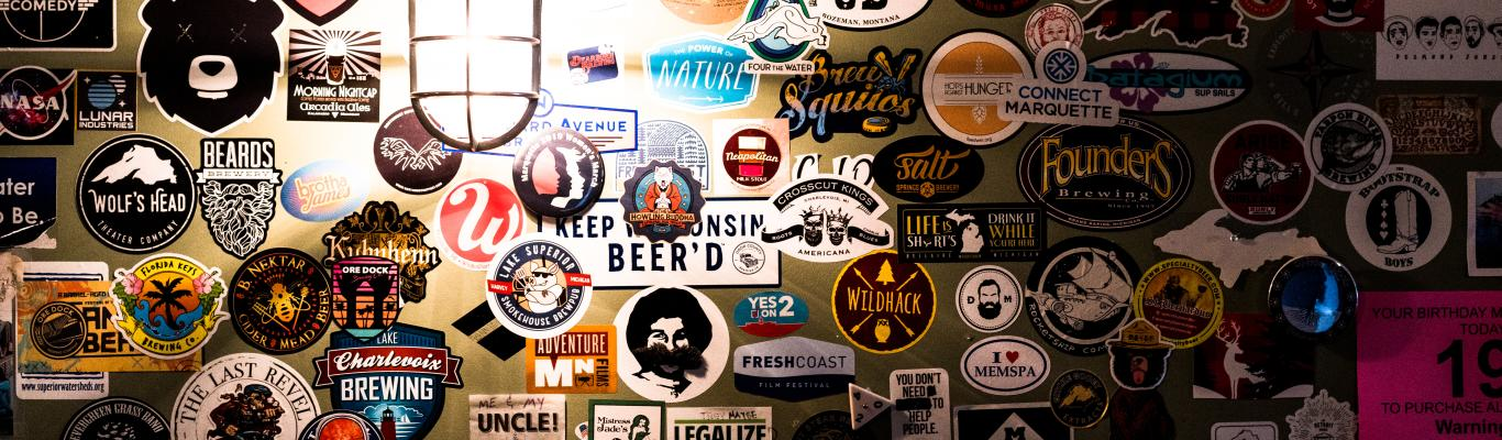 Wall of stickers at Ore Dock Brewing Company