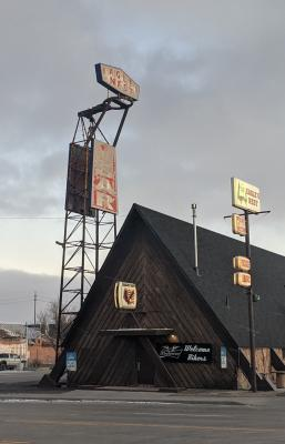 The sign for the Eagle's Nest Bar in Cheyenne, Wyoming, perched on a repurposed missile cradle