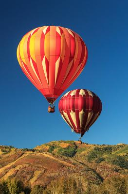 Two hot air balloons over Park City mountains during Autumn Aloft