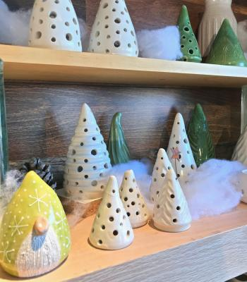 Yellow clay gnome and white tree-shaped votives