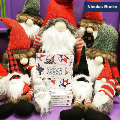 Nicolas Books stuffed Santa book display