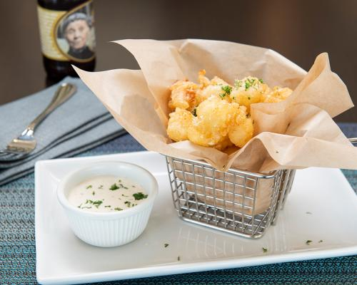 Cheese curds and a dipping sauce at DoubleTree by Hilton Madison East