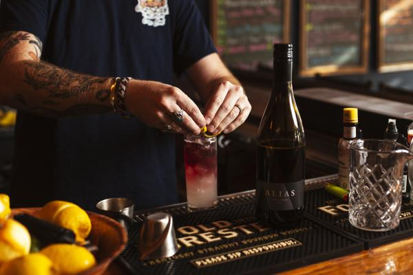 Bartender making a cocktail at Alcove Cocktail
