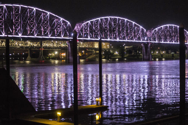Lighted Big Four Bridge over the river at night