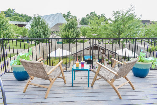 Patio chairs and table on a deck at Fresco Tea Bar in Jeffersonville