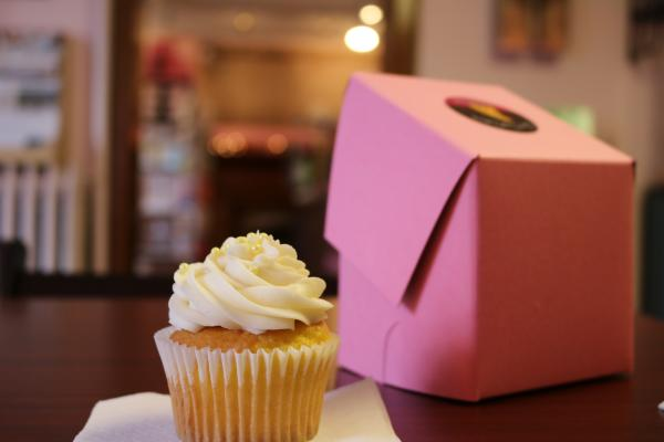 Vanilla cupcake and pink box from Our Cupcakery