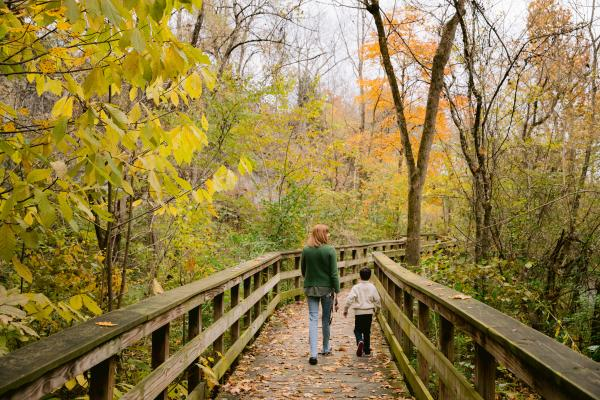 Mother and son walking the observation deck at Hayden Run Falls surrounded by fall color.