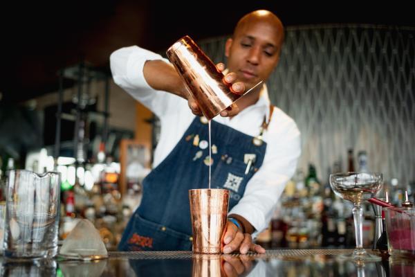 VASO Trey Willis mixologist pouring cocktail