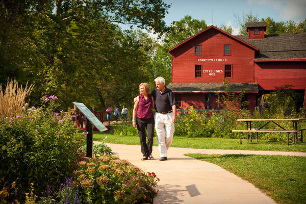 Visitors enjoy a walk along Elkhart County's Heritage Trail by Bonneyville Mill.