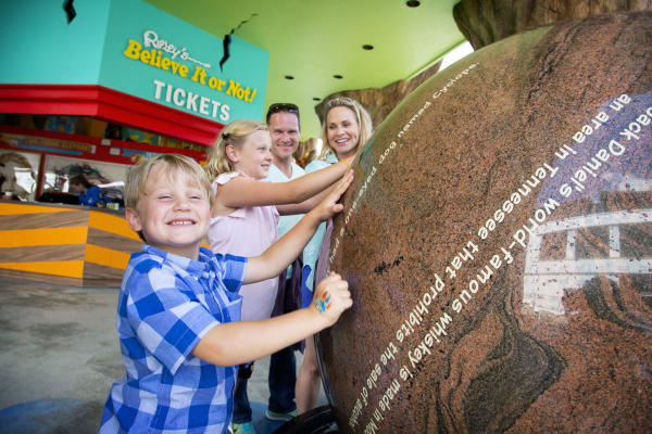 A group of children interact with a display at Ripley's Believe it or Not!