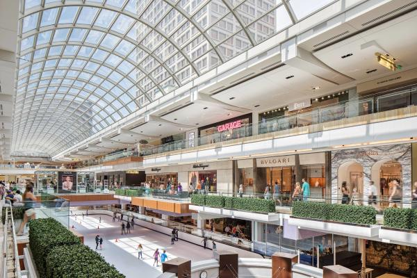 Shoppers enjoy the open space and sunlight at The Galleria in Houston.