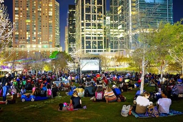 People watching a movie outside in the evening in Houston