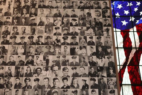 A wall of WWII service members at the Dole Institute in Lawrence, Kansas.