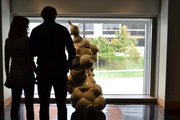 Silhouette of a couple at a museum
