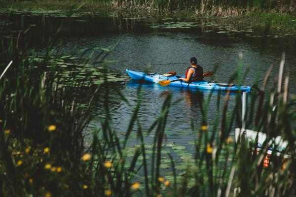 Kayaking on the river on a beautiful day with Prairie Sea Kayak