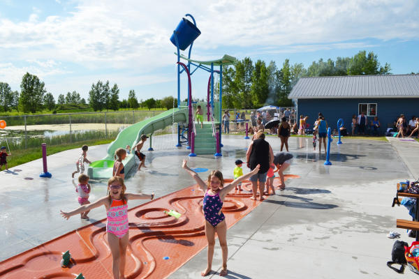 Kids enjoying the splash pad at the Pipestone Waterpark