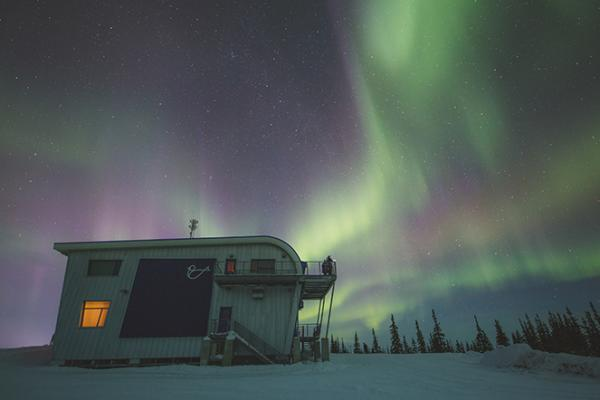 Northern lights over a Churchill Northern Studies Centre building
