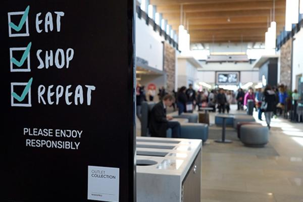 Eat Shop Repeat sign at OC Winnipeg outlet mall