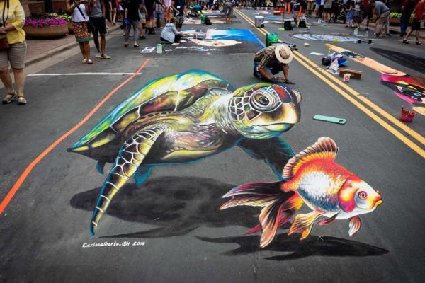 3D sidewalk chalk art painting of a sea turtle and fish