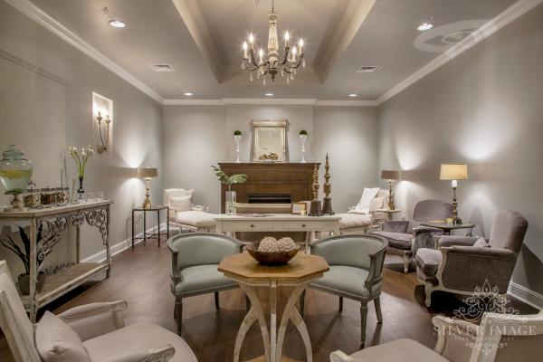 A group of chairs in a white room at the entrance of Woodhouse Day Spa