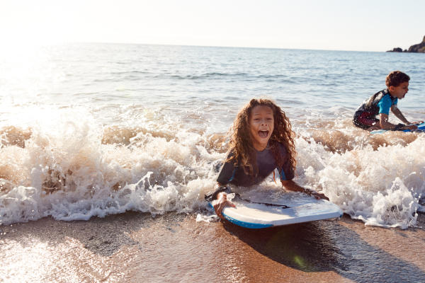 Kids playing in surf
