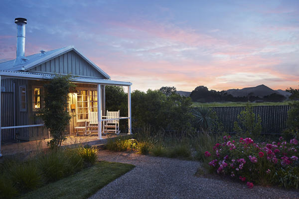 The sun sets over the colorful flowerbeds at Carneros Resort and Spa