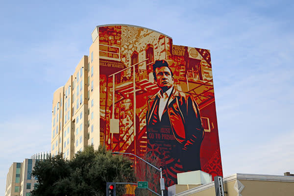 mural of johnny cash on the side of the residence inn hotel
