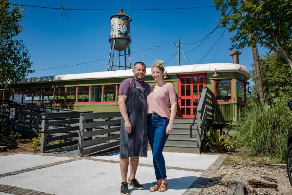Keith and Nealy Frentz of Lola Restaurant with their train car dining room