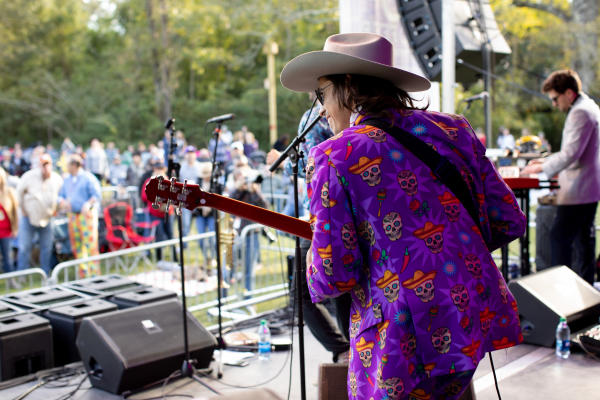 Guitarist performs for the crowd at Abita Fall Fest