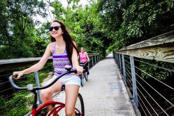 Woman Biking the Tammany Trace near Lacombe