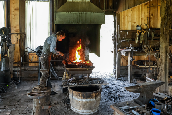 Working the irons at the blacksmith shop at George Ranch Historical Park