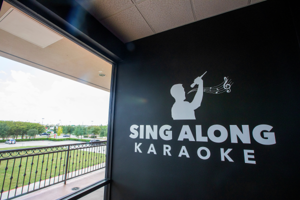 Sing Along Karaoke sign just inside the front window by the entrance