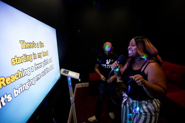 Singing a tune at Sing Along Karaoke.