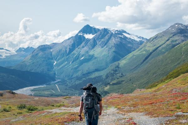 a hiker on a trail in the mountains