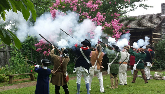 Sons of the Revolution at James White's Fort shooting guns in the air