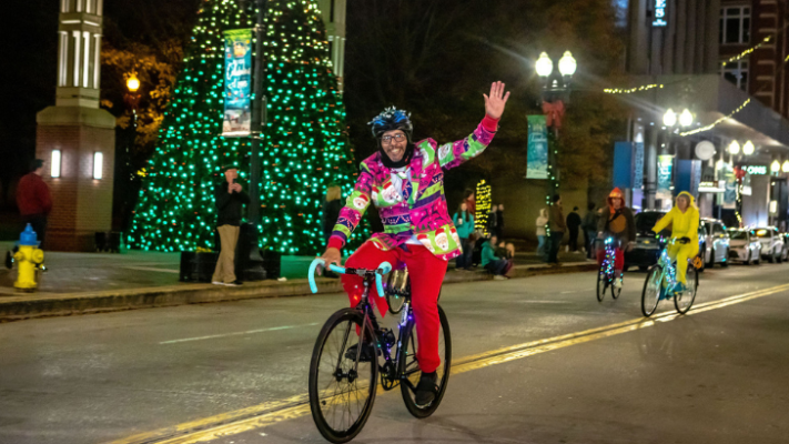 Man riding a bike in Tour de Lights