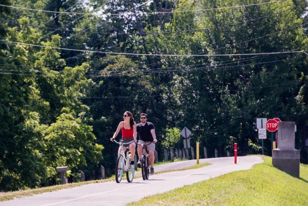 Couple riding bikes on the Ohio River Greenway