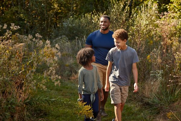 Dad walking trail with son and daughter