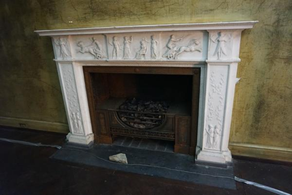 Eugenia Williams House Fireplace with engravings of people around edges