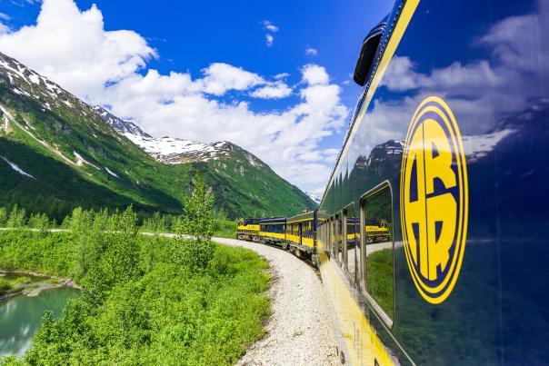The Alaska Railroad's Glacier Discovery Train steams through the Chugach Mountains and the Grandview area.