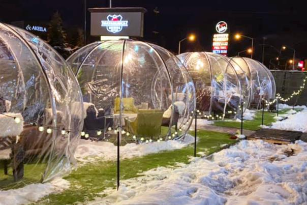 Staying cozy in an igloo while dining at Matanuska Brewery in Anchorage, Alaska.