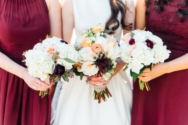 The bride and bridesmaids show off their bouquets.