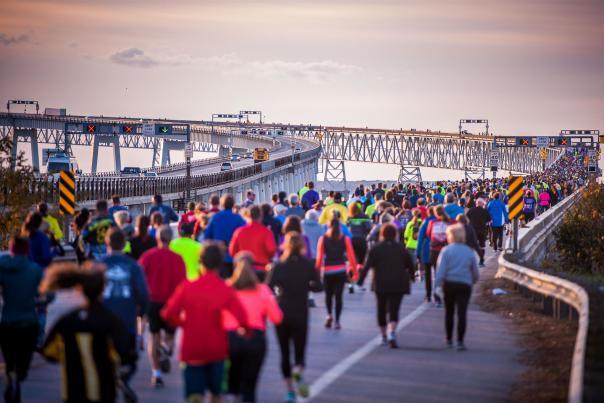 Runners running across the Chesapeake Bay Bridge
